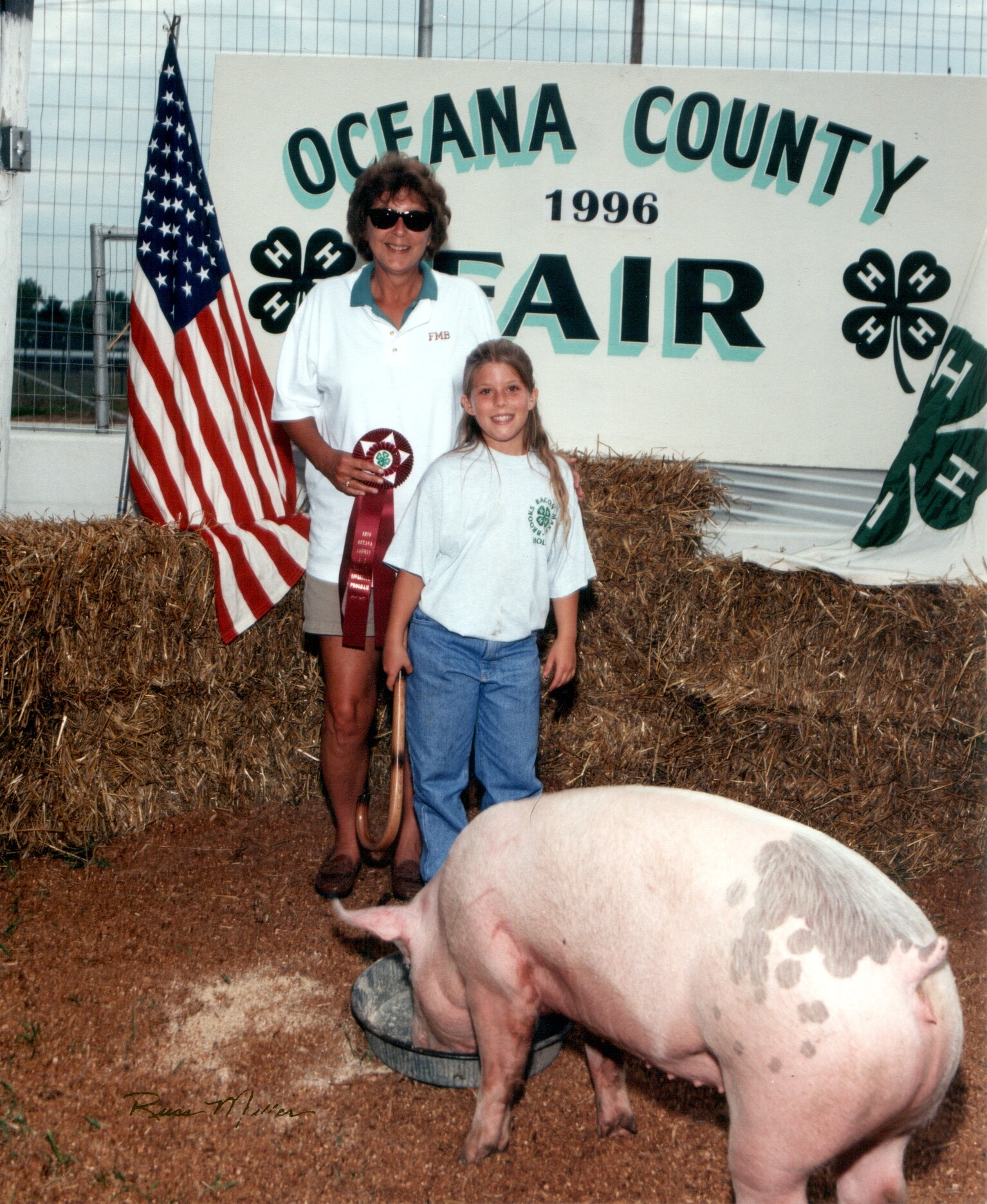 Holly Snider Buck with her Reserved Grand Champion Hog